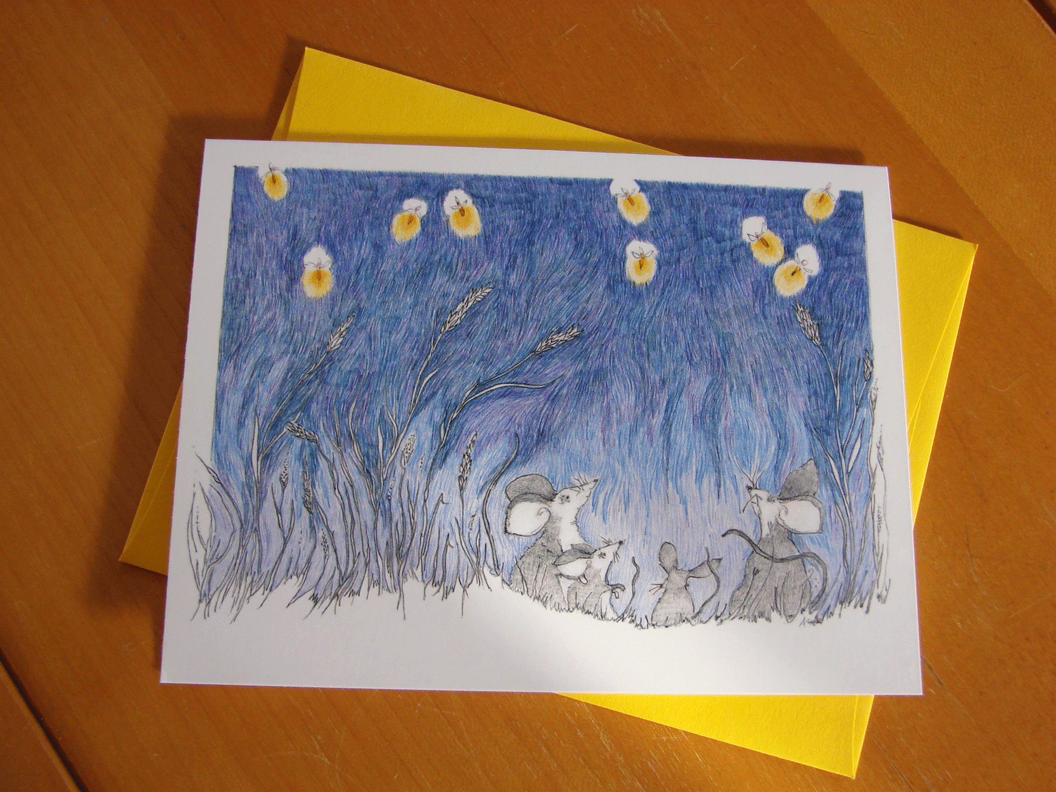 Photo of a card featuring fieldmice watching a display of fireflies.
