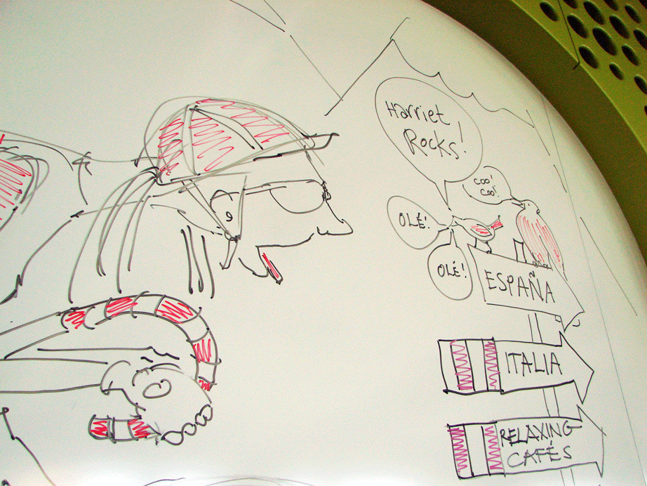 Drawing of cyclist working hard to ride up a VERY steep hill.  Dry-erase marker on white board, 2016.