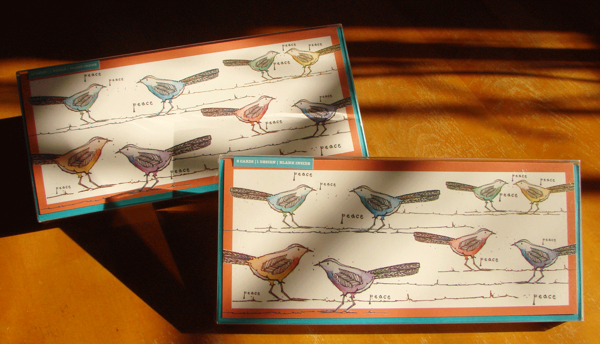 Photo of card sets featuring flittering, twittering birds and a message of peace.